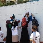 طلاب التداخل الإجتماعي يقومون بأعمال تطوعية في حي المعلقة